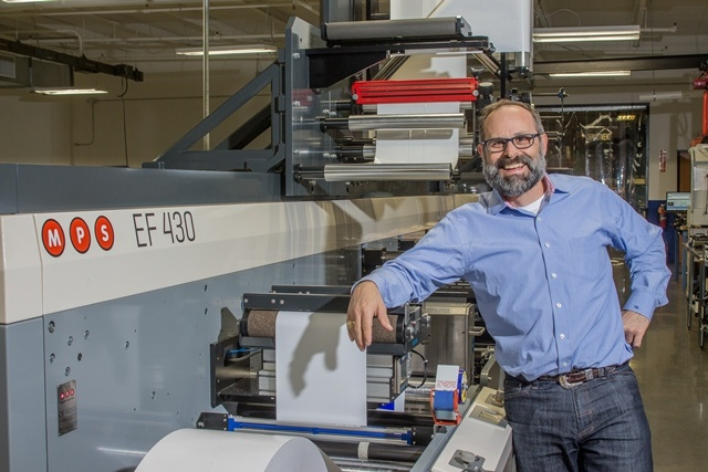 1. Thomas Dahbura, President of Hub Labels Inc. with the new MPS EF press