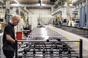 commissioning engineer working on assembly of MPS flexo press
